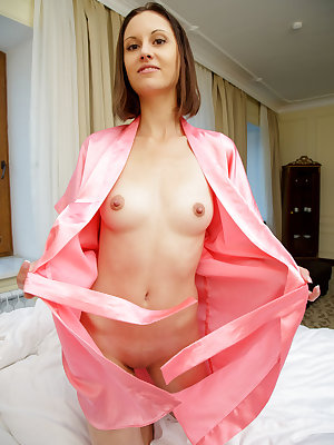 Sade Mare sensually poses on the bed showing off her sweet pussy.