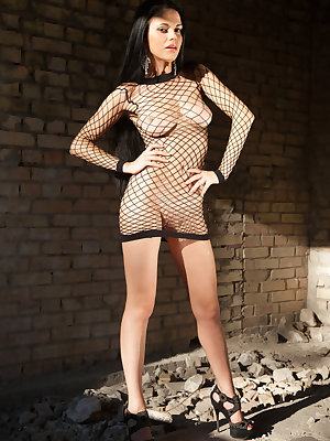 Mirela A wearing a black fishnet lingerie and matching strappy stilettos