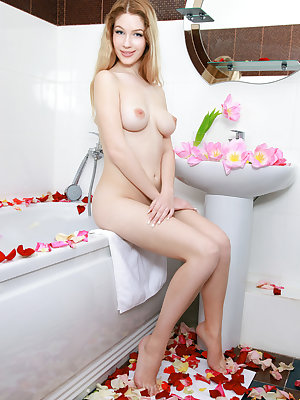 Genevieve Gandi dips her delectable body in the bathtub.