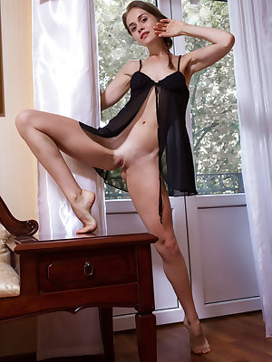 Maria Espen flaunts her tight ass and small pussy on the chair.