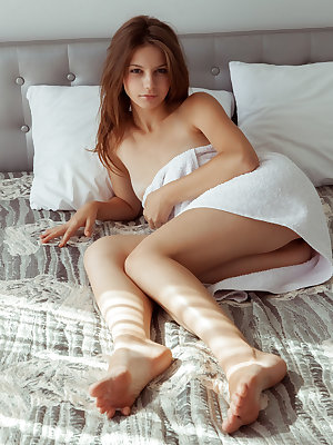 Emma Sweet sensually poses on the bed as she flaunts her slender body.