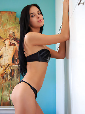 Venice Lei strips her black lingerie on the bed as she displays her unshaven pussy.