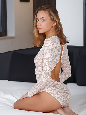Beautiful Mango A bares her petite body and sweet pussy on the bed.