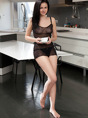 Mazzy enjoys a cup of coffee before treating us to a delicious showcase of her assets