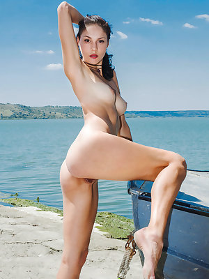 Callista B shows off her smoking hot body as she poses by the beach.
