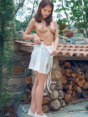 Hilary C strips outdoors as she bares her puffy tits and delectable pussy.