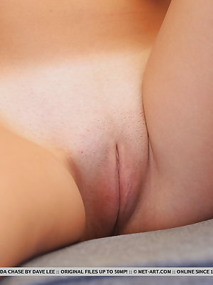 Linda Chase flaunts her slender, nubile body and smooth pussy on the table.