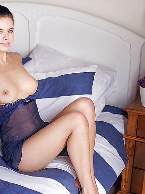 A beautiful Carmen Summer takes off her delicate blue lace lingerie