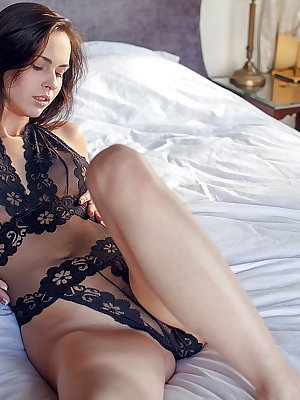Nasita wearing a sheer black lace lingerie that hugs her beautiful perky breasts and tight ass