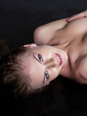 Flavia captivates you with her dazzling and mischievous smile as she seductively unbuttons her white blouse exposing her small perky breasts.  Her body is lithe and petite and she loves posing in provocative positions that show off her womanly charms.