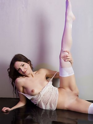 Lovely and daring Dasha doesn't mind showing off her agile petite body. She looks so sweet and innocent in her white top and thigh high stockings.