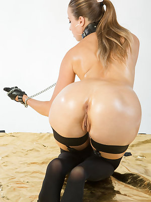 A breathtaking view of Taissia's oiled up nubile body as she poses erotically and playfully teases her delectable pussy with chains.