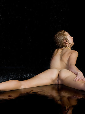 Drenched and wet, Renata flaunts her lean and nubile body and takes pleasure in flirting and teasing on the damp floor.