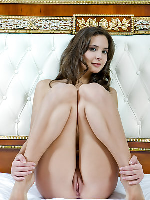 A stunning goddess with an amazing body and beautiful puffy breasts, and gorgeous sexy legs, coupled with erotic, and raunchy poses on top of the bed.