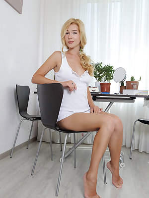 Cute and charming Genevieve Gandi sensually stripteasing for the camera