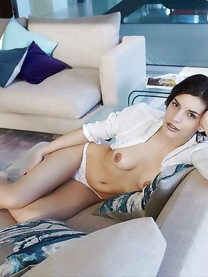 Stunning and sexy Candice Luka stroking her meaty pussy in the couch
