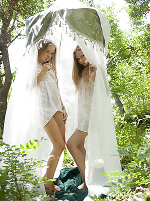 Alisa Bri and Milena D portray a pair of playful sexy forest nymphs