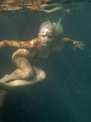 Nika N in a sexy, wet, underwater shoot at the beach