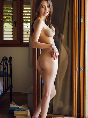 Mila Azul playfully showing off her big, puffy breasts