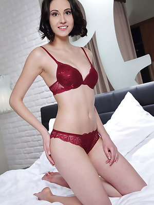 Sweet and charming Sade Mare slowly undressing her champagne red lace lingerie and spreading her legs wide open on top of the bed