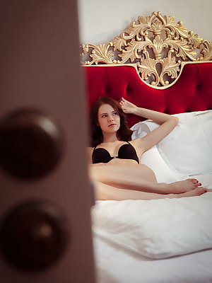 Juliett Lea performs a slow and sensual striptease on top of the bed
