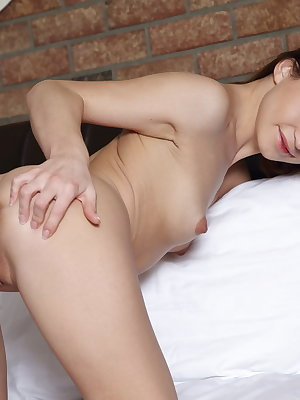 Soft and sensual, Susie spawls on top of the bed, showing off her smooth ass and lickable snatch
