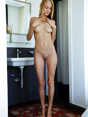 Blue-eyed babe Nancy A flaunts her long and slender body and smooth assets