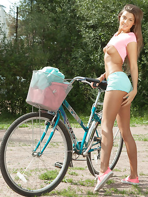 Melena A starts her days with a naughty bike ride before coming home to masturbate in the couch