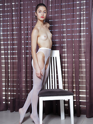 Blue-eyed stunner with pretty face, Clarice A looks spectacular in white fishnet pantyhose that shows off her lean and slender physique