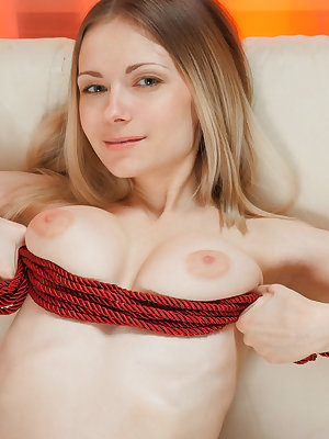 Busty blonde with a charming personality, Lenore enjoys a brief bondage exhibition before proceeding to masturbate on the couch