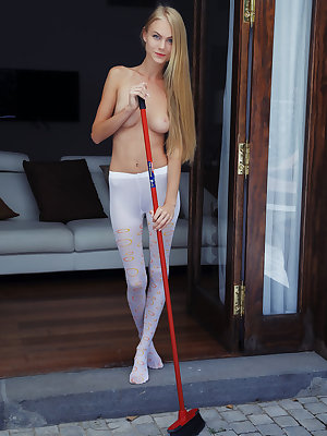 Blue-eyed stunner Nancy A poses in her white stockings that shows off her long and slender physique