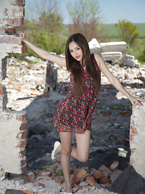Li Moon undresses amidst the ruins and shows off her juicy, Asian ass