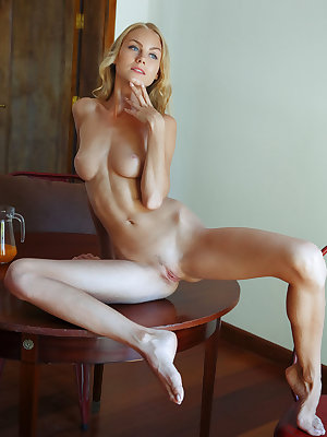 The beautiful Nancy A poses and seduces with her striking blue eyes, lean physique with puffy nipples, cute ass, and sexy long legs.
