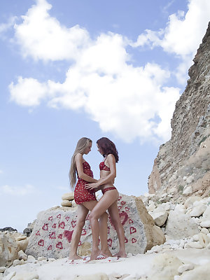 Two lusty cuties, Milena D and Korica A, licking and stroking each other's pussy by the beach