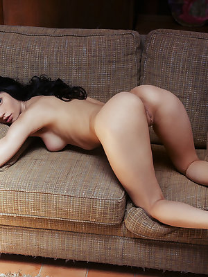 Seductive Dita V with lusty eyes and wide open poses masturbates on the couch