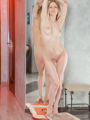 Lenore confidently posing naked and showing off her pink, succulent assets