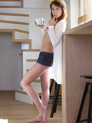 Mina A enjoys her morning brew before proceeding to tease and masturbate in the kitchen