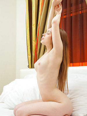 Young and beautiful, Winnie sprawls her nubile body on top of the bed and starts finger-fucking her pink, shaved pussy