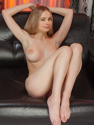 Lenore is a lovely young maiden who has no inhibitions when it comes to exposing her naked body.  She sits naked on her leather couch fingering her smooth exposed pussy.  One finger leads to four fingers as she spreads her legs and stretches her pussy wid