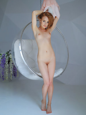 Demure and lovely Lenai with penetrating ice blue eyes is sure to captivate you.  Relaxing in her hanging lucite bubble chair she gives you a little peek-a-boo tease before slipping out of her pink frock and exposing her perfect  petite body.  Small lovel