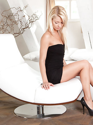 Gorgeous Grace C looks stunning in her black tube dress and peep toe platform stilettos relaxing on her chaise lounge.  She is poised and captivating as she exposes her black panties and slips off her dress.  Relaxed and uninhibited, she slips off her pan