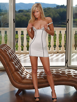 Miela A is enjoying a beautiful sunny afternoon out on her balcony.  You can see by the look on her face she is feeling restless and aroused as she begins undress and fondle herself.  She leans back on her exquisite brown leather chaise lounge and begins