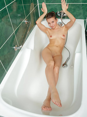 It's bath time for Breann and what's a bath without toys to play with?  She brings out the silver bullet and begins to tease her smooth, dark pussy lips alternating between the bullet and the shower massager. Which one will send Briann over the ed