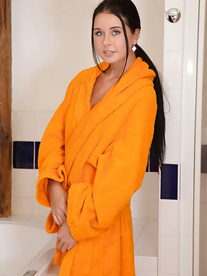Mia Manarote is ready for some bathtub fun as she drops her bright yellow robe and climps into the tub.  All wet and soapy she begins to fondle her luscious breasts and then spreads open her inviting smooth pussy for some shower massage masturbation. A gi