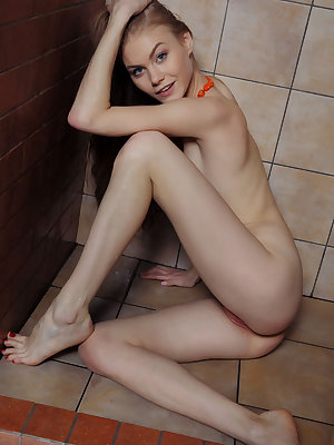 Playful and provocative, Nancy A is ready for some hot, wet, shower fun.  Wrapped in her white towel wearing her orange beads, she exposes her her full supple breasts as she toys with her hard nipples.  As she steps into the shower, she sits on the floor