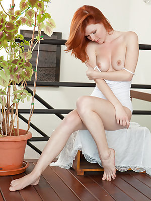 One of our favorite redhead models, Mia Sollis, with her pretty blue eyes and cute freckles, enjoys getting naked in front of the camera and enjoying a deep and sensual finger fuck.