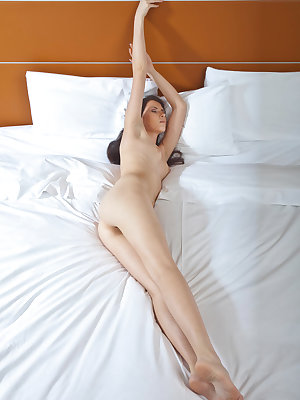 Young, sensual, and uninhibited, Margo makes an erotic self-masturbation scene on top of the bed as she satisfies her wet and needy cunt with her fingers.