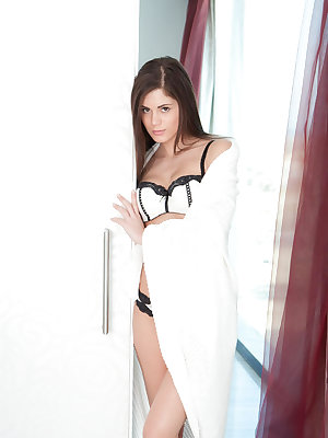 Seductive sizzler Caprice entertains her fans with sensual and subtly erotic poses as she strips her sexy lingerie and masturbates on the couch.