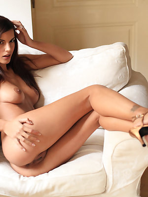Candice Luka is a stunning brunette model blessed with a beautiful slender physique and toned assets. She strips her shirt to flaunt her magnificent puffy breasts, toned torso and scrumptious shaved pussy.