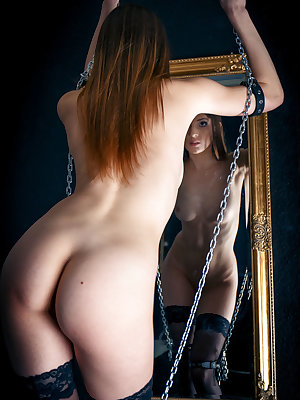 Marlyn flaunts her lusty body as she plays with her shackles by the mirror.